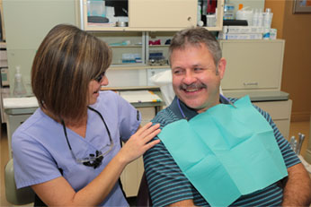 Dental Hygienist comforting patient