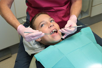 Young patient receives dental work
