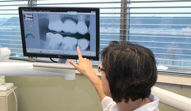 Dr. Le Saux showing dental x-rays
